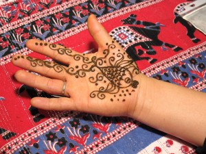 "Traditional designs are applied at the henna booth in the bazaar (""charshija"") on the balcony"